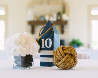 Set of 12 buoys. Navy and white Nautical Table Numbers. Lobster Buoy Table Numbers. Navy Wedding Decor. Beach wedding. Reclaimed wood buoys.