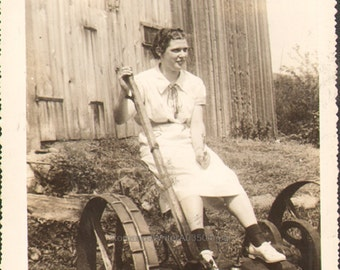 Woman sits on an Old Fashioned Mower Vintage Photo of Carolyn Pearson