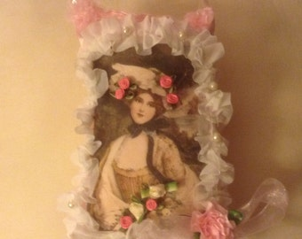 7 inch lavender scented sachet in pink with image of Victorian lady surrounded by white trim