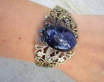 Blue Goldstone Galaxy Glitter Stone Brass Cuff