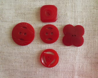 Vintage beautiful Bakelite red various shapes and size sew hole buttons. 5 buttons.