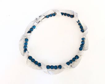 """Blue rhinestones and silver tone link bracelet 7"""" long - fold over clasp"""