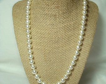 1966 String of white Faux Pearls.