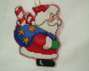 1994 Handmade Plastic Needlepoint Santa Claus Ornament.