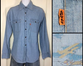 1970's Levi's Blue cotton chambray work shirt orange tab size large with flying antique airplane print on the back