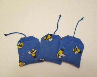 Set of three (3) cat or kitten all natural catnip toy with bumble bees on a blue background
