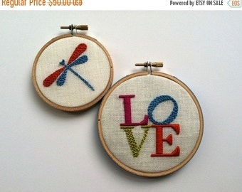 On Sale LOVE & Dragonfly.  hand embroidery.  hoop art.  home decor.  wall wear.  magenta. aqua.  citrine.  orange.  hand embroidered by mlmx