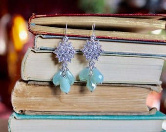 Sparkling silver rhinestone snowflake earrings with dangling ice blue tear drop beads, Across the Tundra
