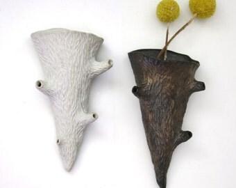 Faux bois porcelain twig wall pocket, one white & unglazed, one bronze, hand carved