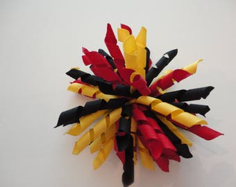 Red, Black, and Yellow Korker