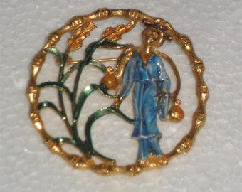 Vintage golden brooch with monk from the 70s.