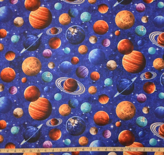 Northcott across the universe planet toss cotton for Fabric planet