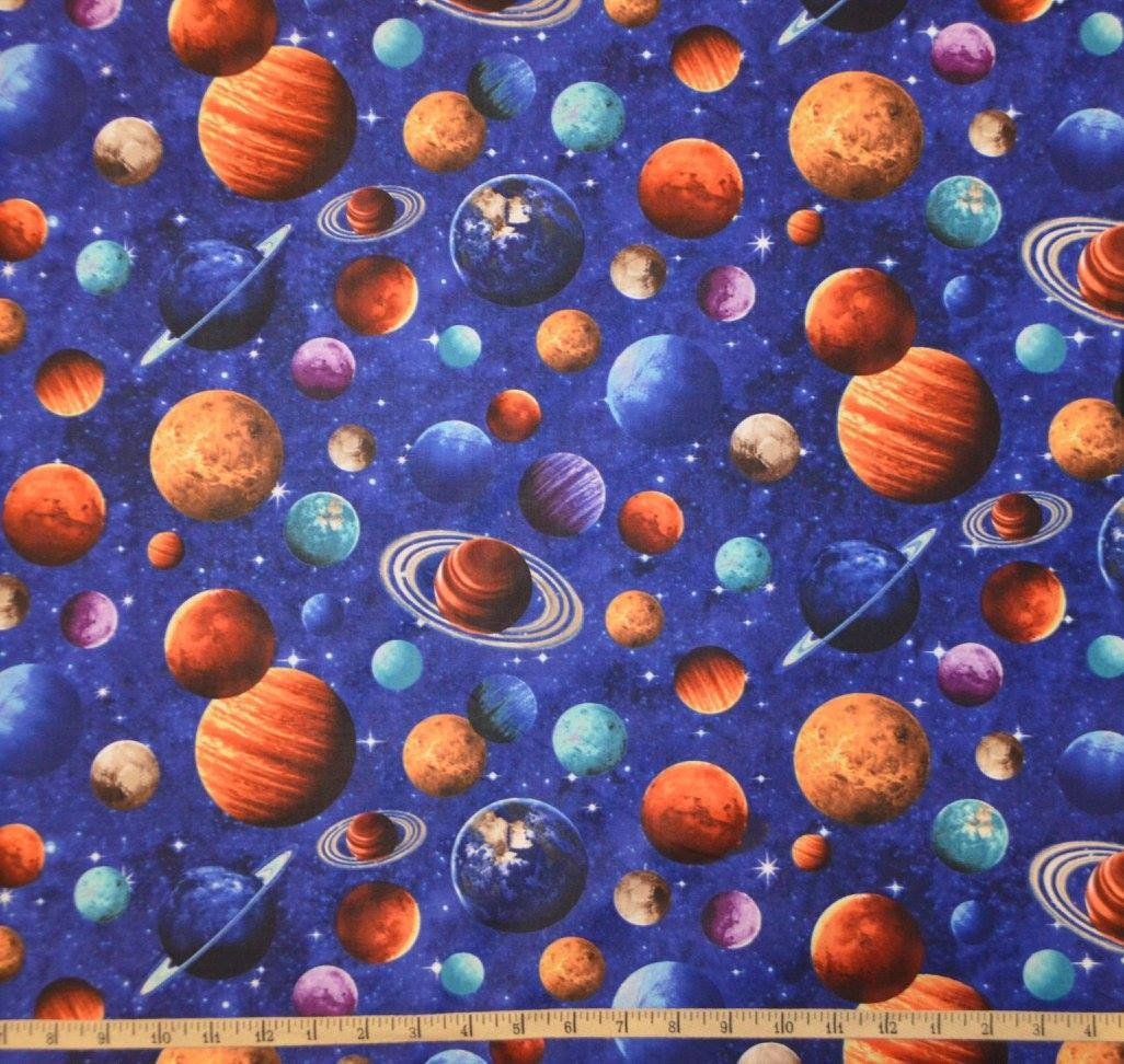 Northcott across the universe planet toss cotton for Outer space fabric by the yard