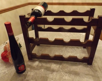 Large wooden wine rack .Excellent sturdy condition. The rack holds 12 bottles of wine. Brown storage.Home decor. Gift