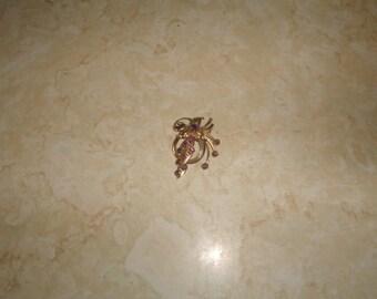 vintage pin brooch goldtone swirl purple rhinestones
