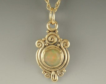 P669- 14ky Pendant with Ethiopian Opal- One of a Kind