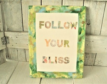 Collage painting canvas sign with text positive message follow your bliss greens golds