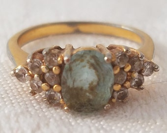 Vintage gold tone ring with oval blue stone and pave rhinestones