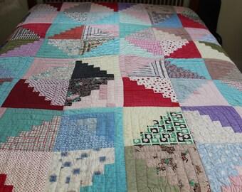 Vintage hand stitched log cabin quilt