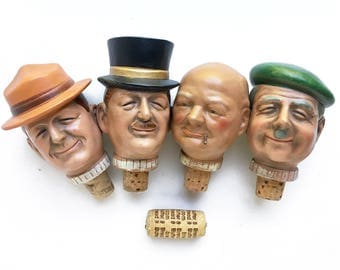 figural bottle stoppers, vintage composition personality heads, Winston Churchill collectible, whiskey cork