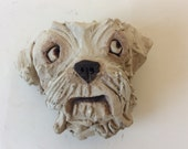 Wall mounted head sculpture by olivia brown llasho