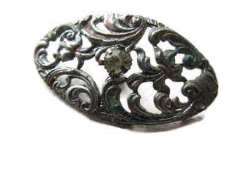 old Victorian oval-shaped filigree button with rhinestone center