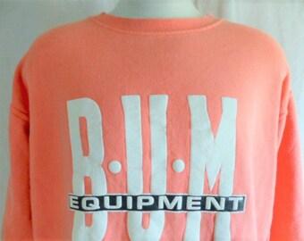 vintage 90's 1992 B.U.M. Equipment peach orange pink fleece graphic sweatshirt white black puffy print logo crewneck pullover jumper medium