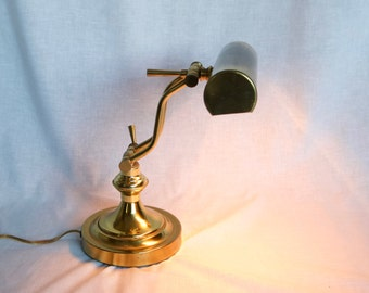 Vintage brass desk lamp with an Edison style bulb.