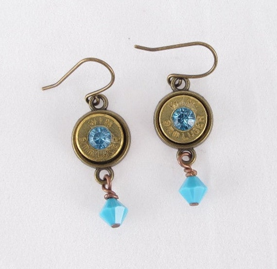 Earrings Wincester 9mm bullet casing with blue Swarovski crystal and blue crystal dangles with brass earring finding and bezel
