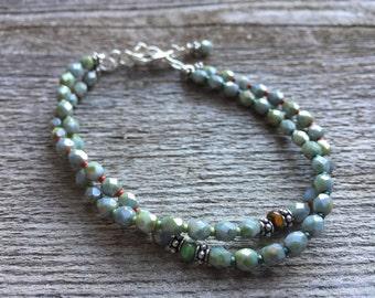 Light blue and green double stranded bracelet
