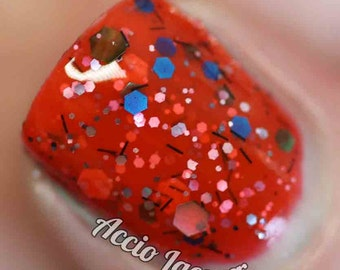 Catch 'Em All Nail Polish - red jelly with multicolor glitter