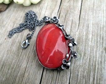 metal  pendant with strawberry quartz cabochon
