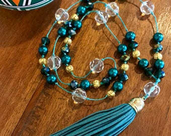 Knotted bead & crystal necklace with suede tassel