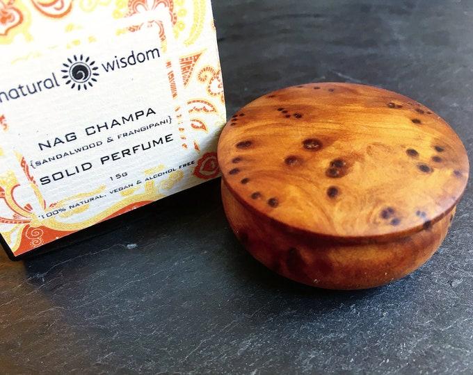 NAG CHAMPA Sandalwood & Frangipani Solid Perfume by Natural Wisdom. 100% natural. Vegan. Alcohol and Gluten free.