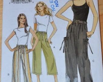 Uncut Vogue 8584 Misses' Pants and Belt, sizes 8, 10, 12, 14