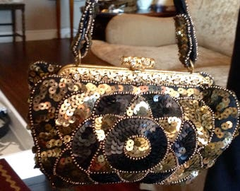 Black and gold vintage bag