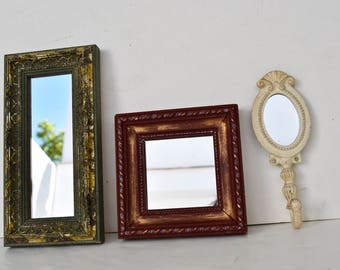 Two decorative mirrors and a hanger with mirror