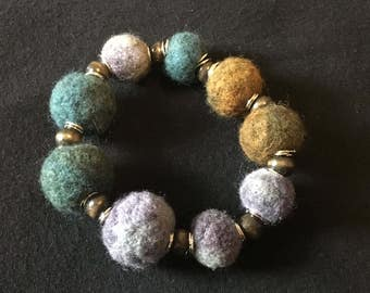 Beautiful hand felted balls with wooden beads and silver rings bracelet