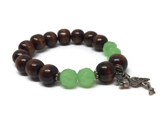 "CLEARANCE *** Wood beads ""baby boy"" bracelet with green faceted glass beads and a stork and baby charm"