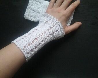 handknitted wristwarmer , cotton, white