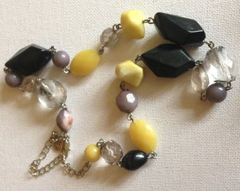 Necklace - funky yellow black clear and grey plastic beaded necklace