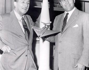 Walt Disney and Wernher von Braun,1954 holding a model of his rocket