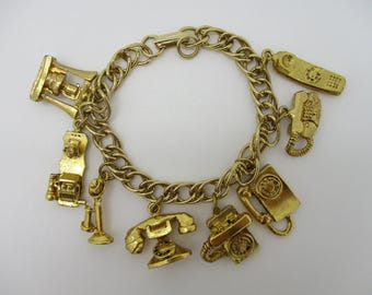 Gold Tone Telephone History Charm Bracelet with 8 Different Telephone Charms