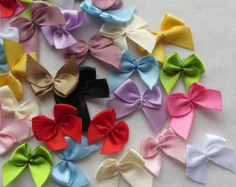 50 x Mini Satin Like Ribbon Bow Appliques. 2cm x 2.5cm. Different Colours Available. Perfect for Scrapbooking, Cardmaking & Embellishments