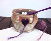 Tan ceramic knitting and ...