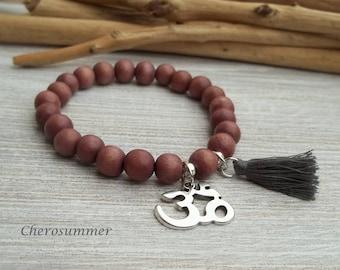 Yoga bracelet wood ohm sign Red Brown