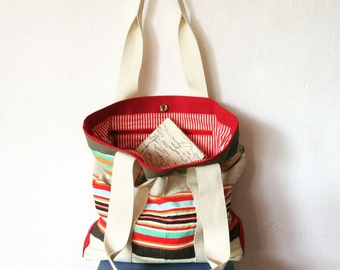 Handwoven cotton beach bag with red stripy lining