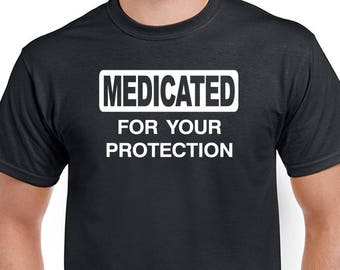 Medicated For Your Protection T-shirt. Unisex funny saying / party shirt.