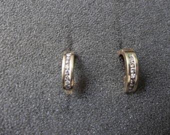 10K yellow gold earrings with .25 CTW  Diamonds 3.1 Grams