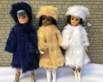 Apricot honey, blue or white Fun Fur coats for Barbie, Sindy and Princess dolls. CE marked and washable.